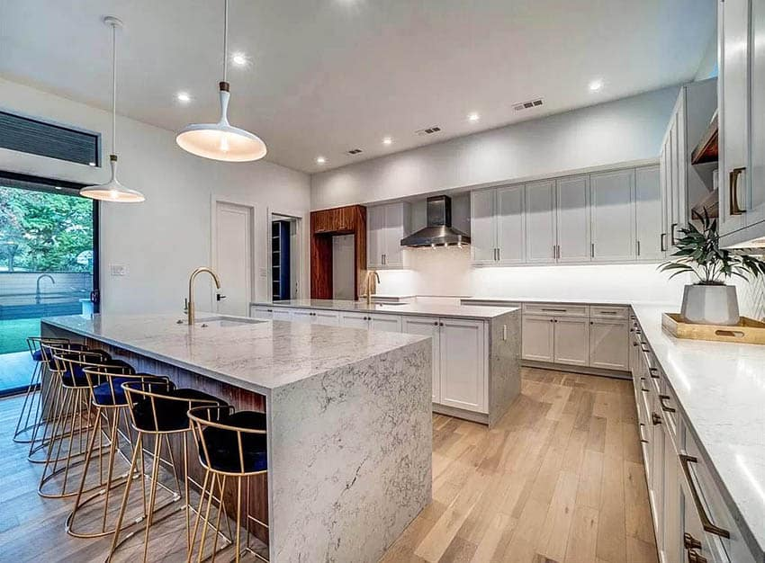 Contemporary kitchen with two islands gray quartz waterfall countertops gray cabinets