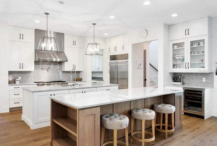Contemporary kitchen with two islands, wood base, white paint base and quartz counters