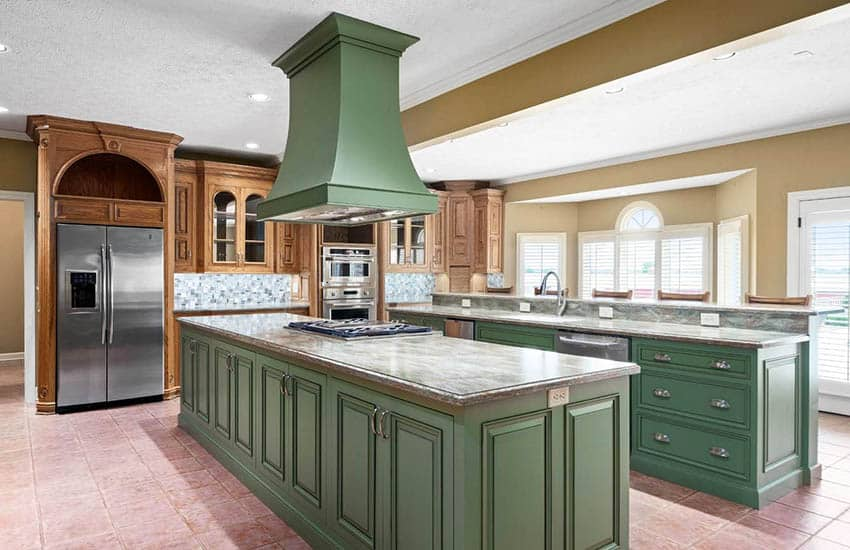 Gourmet kitchen with two green islands center stovetop with custom range hood wood cabinets