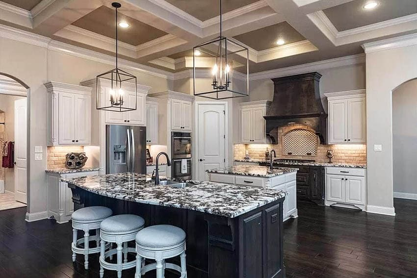 Gourmet kitchen with two islands large custom range hood coffered ceiling
