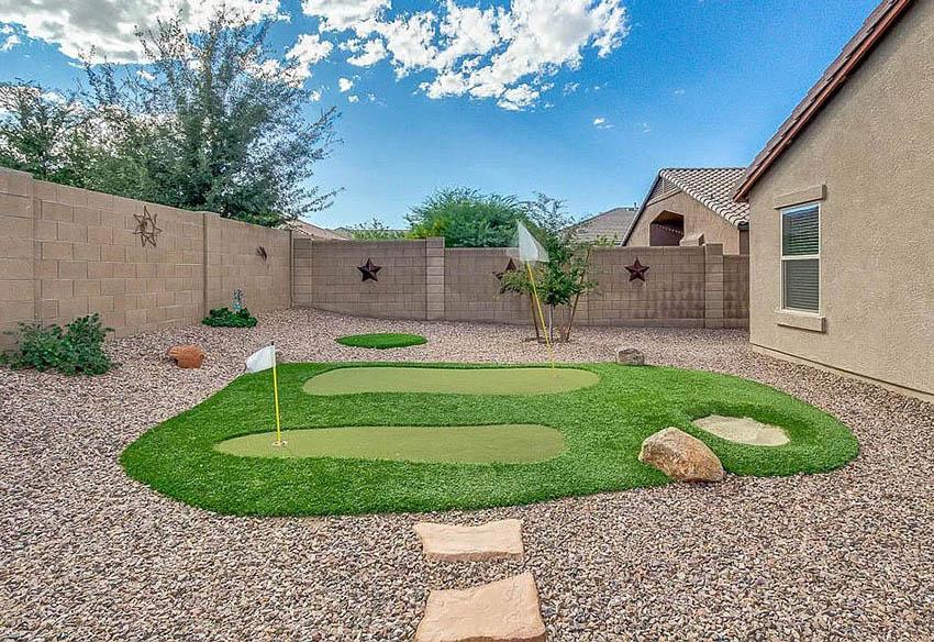 Gravel Backyard With Artificial Grass Putting Green