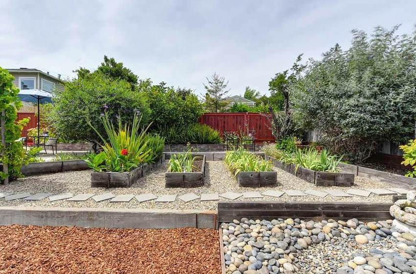 Gravel backyard with garden planter boxes