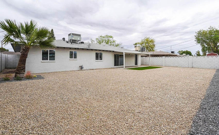 House backyard with full pea gravel design