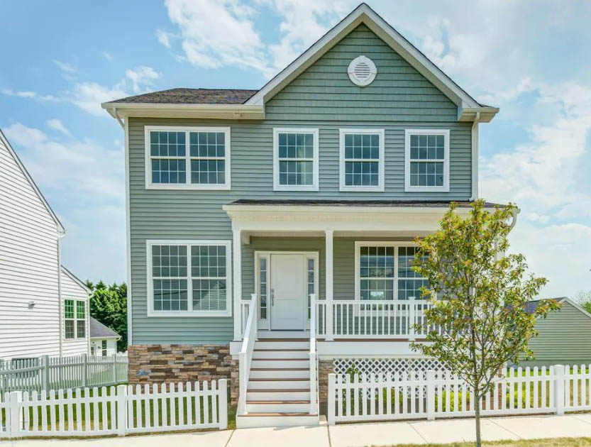 House With Picket Fence And Curb Appeal