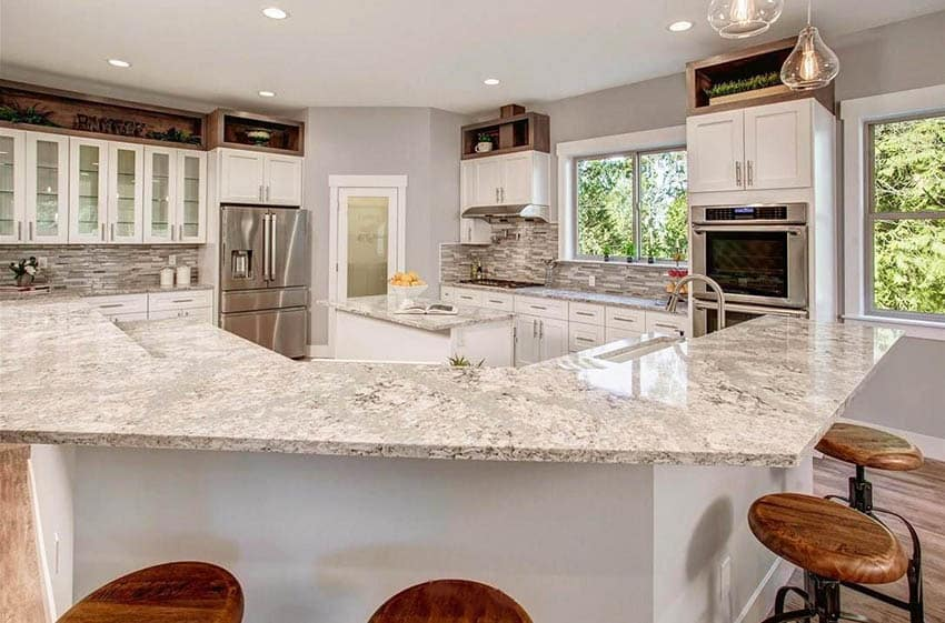 Kitchen with two islands three sided breakfast bar center small island white cabinets