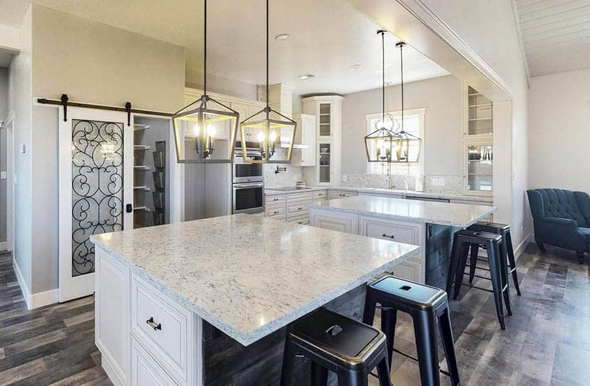L shaped kitchen with two islands white countertops cabinets