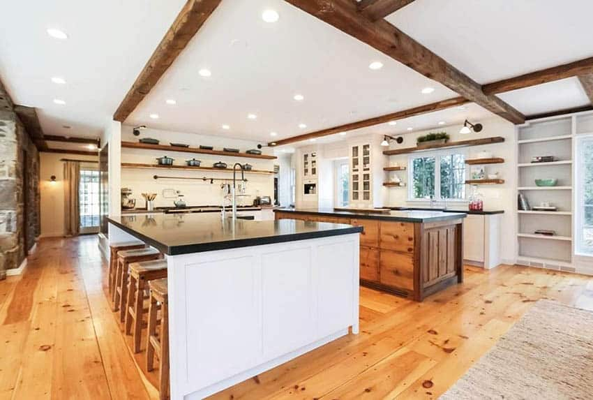 Large modern farmhouse kitchen with two islands open wood beams open shelving