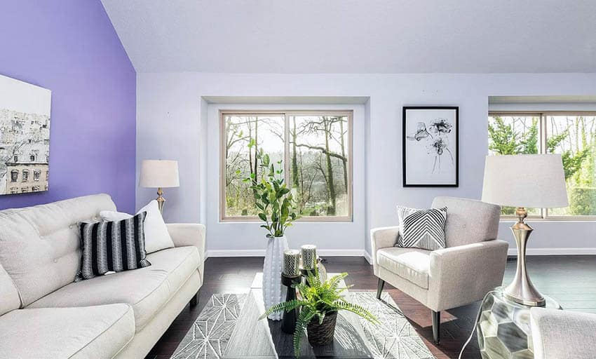 Living room with purple accent wall gray paint and beige furniture