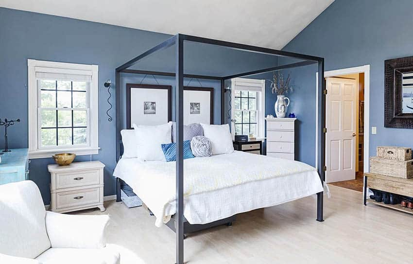 Master bedroom with blue paint and four post bed