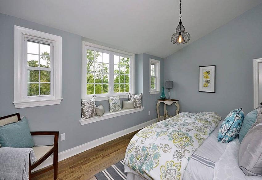 Master bedroom with blue paint and window seat