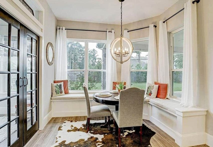 Modern farmhouse built in window seat with dining table