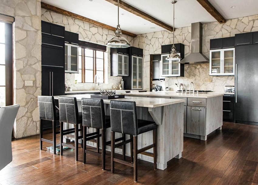 Modern farmhouse with two islands distressed wood cabinets and dark main cabinets