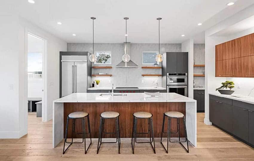 Modern kitchen with three cabinet colors and white quartz countertops