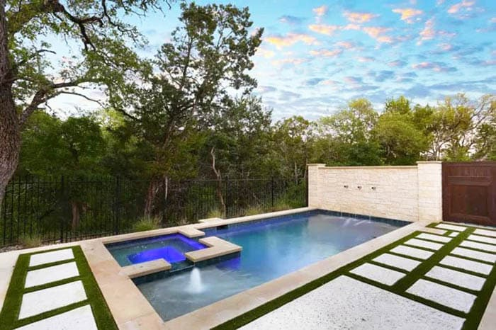Modern Swimming Pool With Accent Wall Fountains