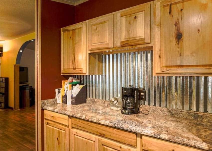 Rustic wood cabinet kitchen with corrugated galvanized steel backsplash