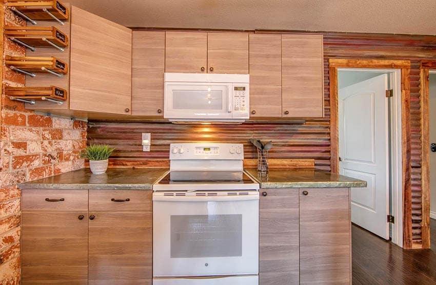 Small kitchen with corrugated metal backsplash veneer cabinets