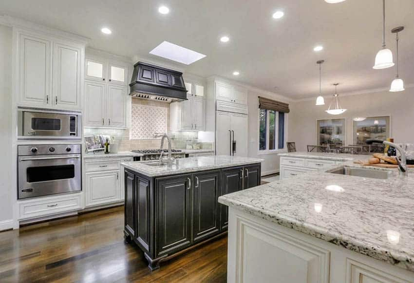 Traditional kitchen with double islands white granite countertops white cabinets