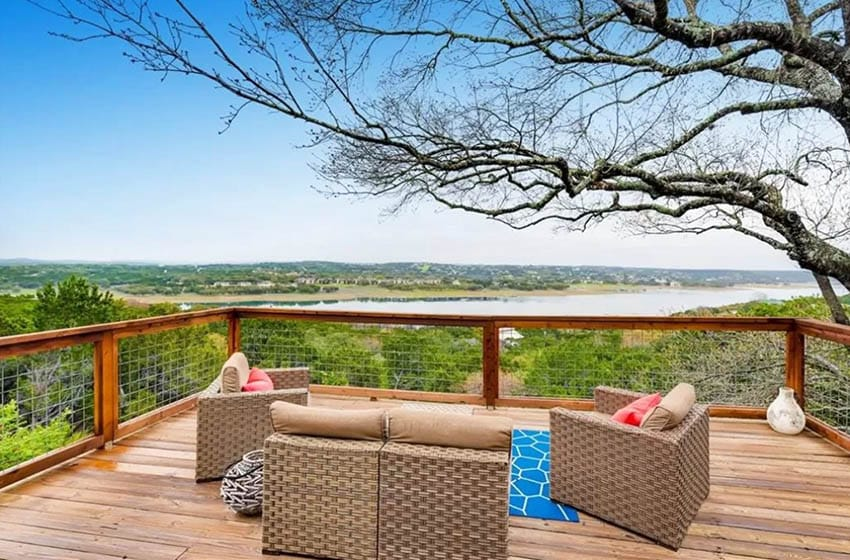 Wood Deck With Railings Outdoor Furniture And Water Views