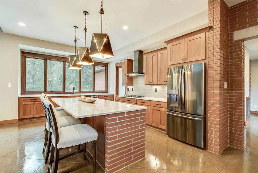 Brick kitchen island with contemporary wood cabinets marble countertops