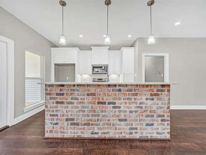 Brick kitchen island with pendant lights