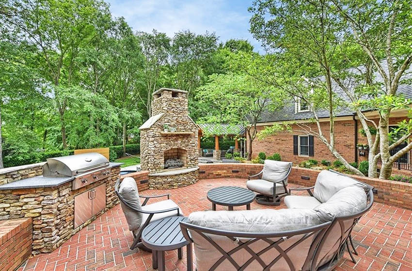 Brick patio with fireplace and outdoor kitchen