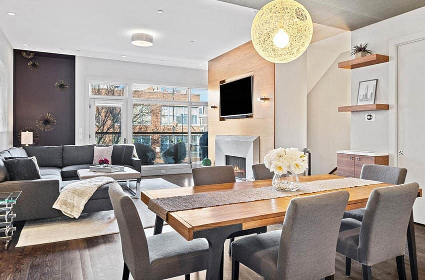 Contemporary dining room with staged table and globe lighting