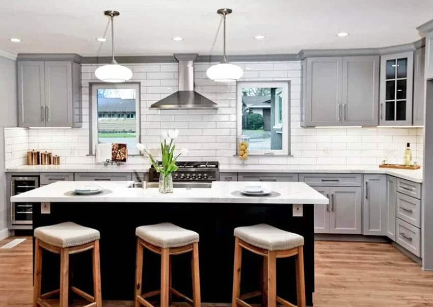 Contemporary kitchen with dark wood island gray cabinets white subway tile