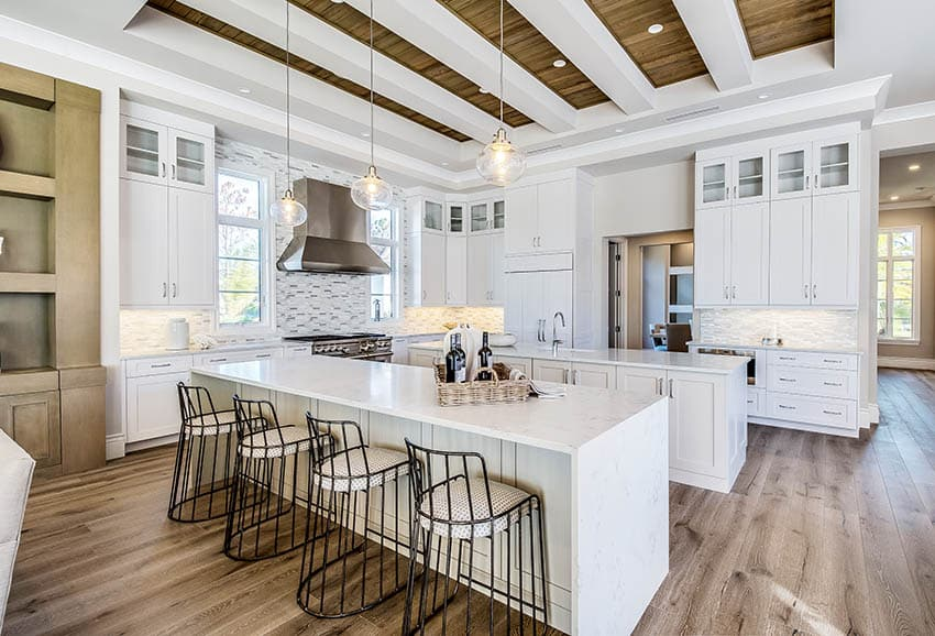 Contemporary kitchen with two islands, white paint base and quartz counters