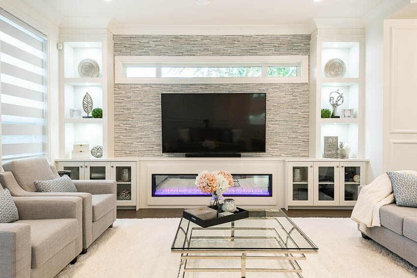 Contemporary living room with lighted recessed wall niches and stacked stone gas fireplace