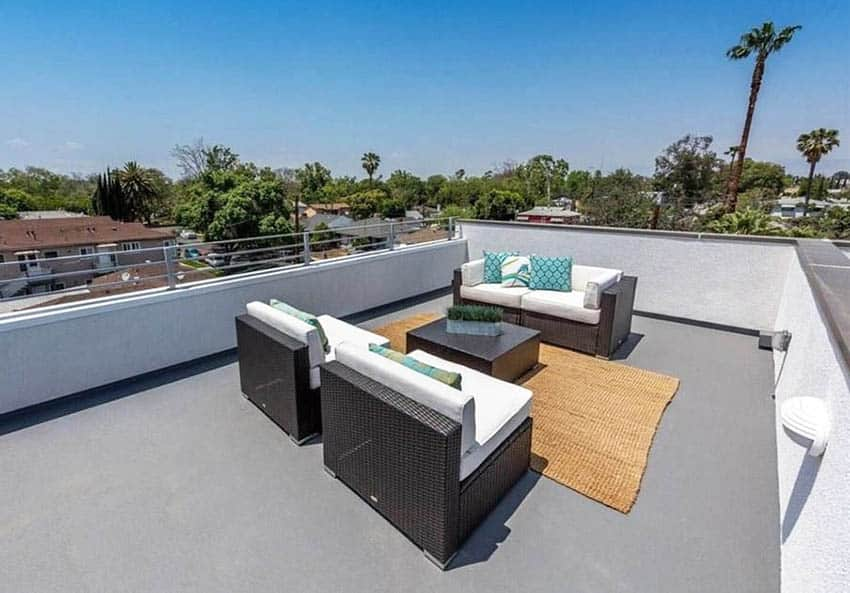 Fiberglass roof deck with jute area rug and outdoor furniture