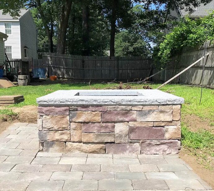 Fire pit with granite top and stone sides