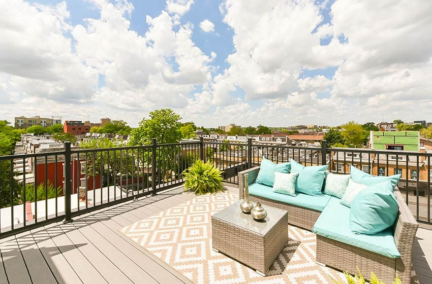 Flat roof deck with metal railing, composite flooring and synthetic wicker outdoor furniture