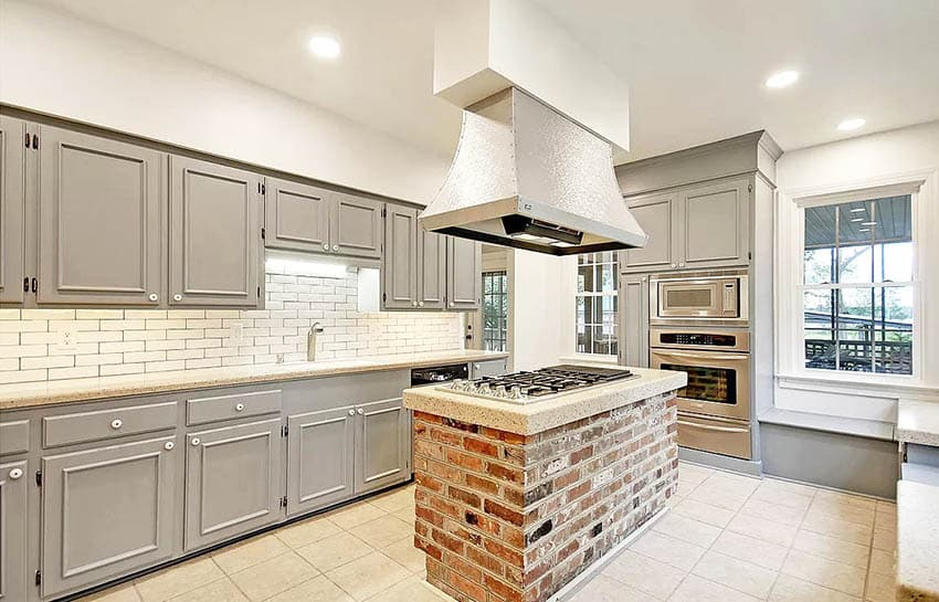 Gray cabinet kitchen with brick island
