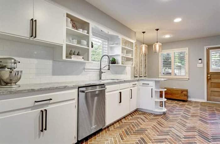 Herringbone pattern brick floor in kitchen