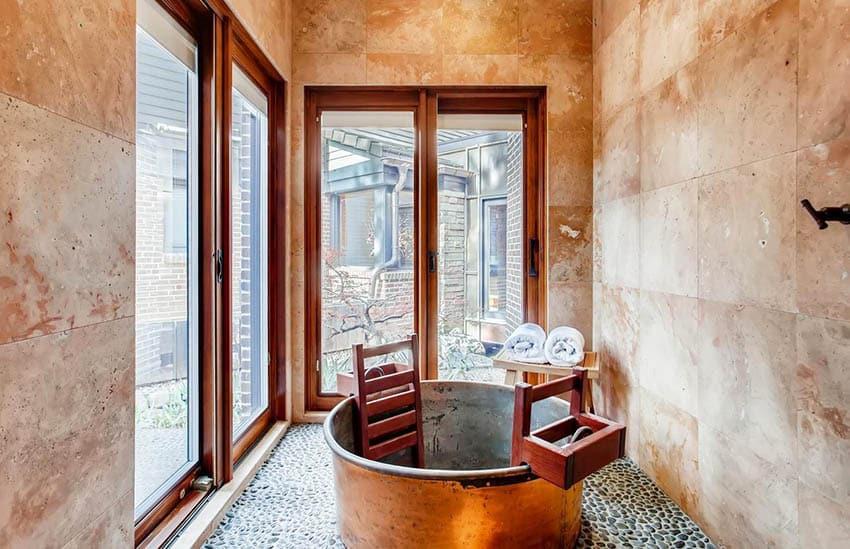 Japanese copper tub river rock floor bathroom