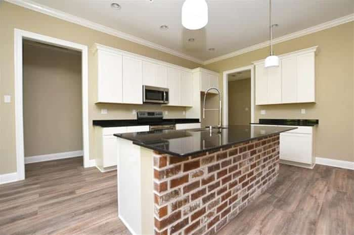 Kitchen island with brick in front