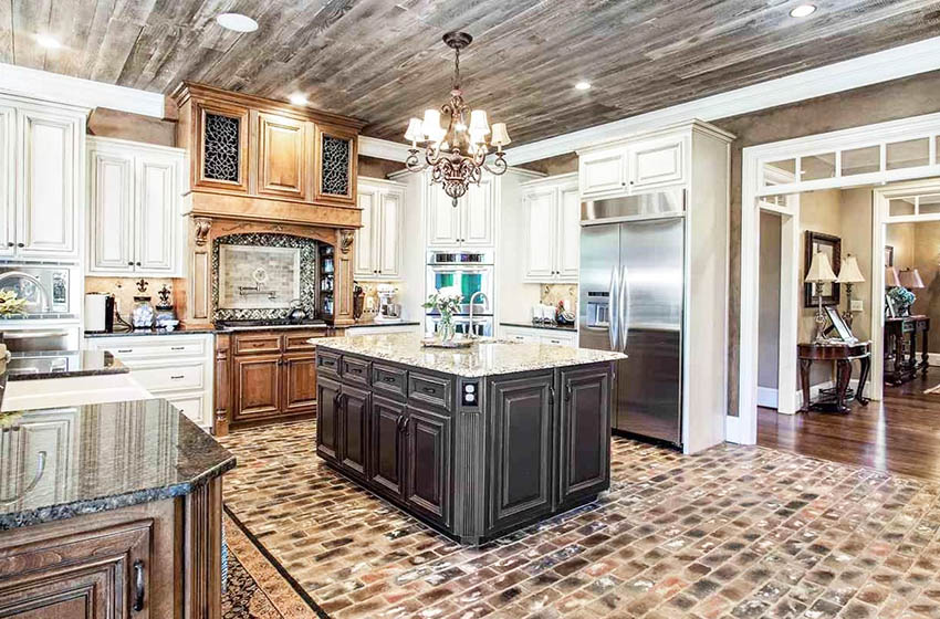 Kitchen with brick veneer flooring, antique cabinets and wood accent ceiling