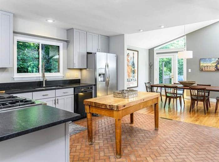 Kitchen with herringbone pattern faux brick floors
