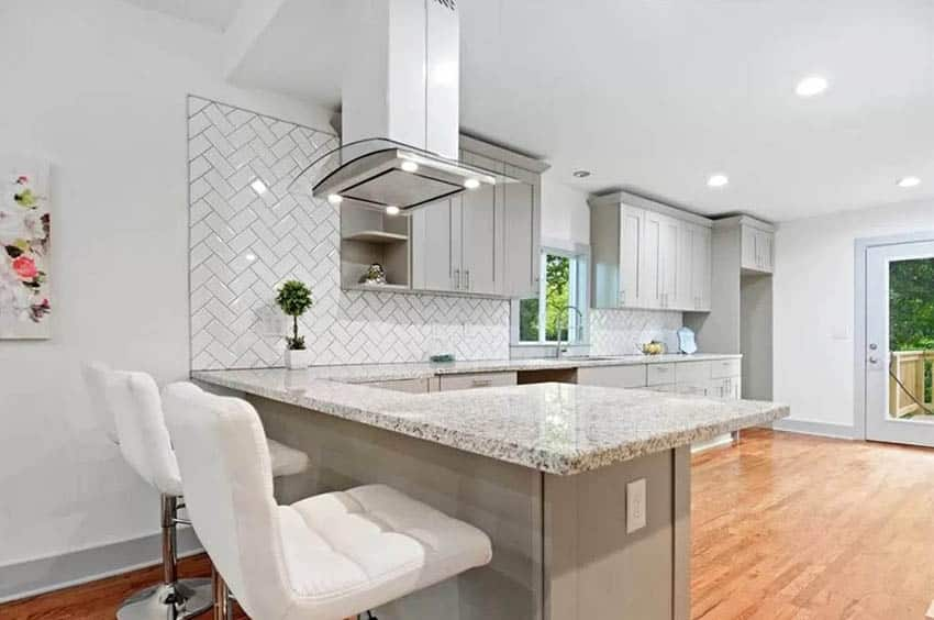 Kitchen with small dining peninsula gray cabinets