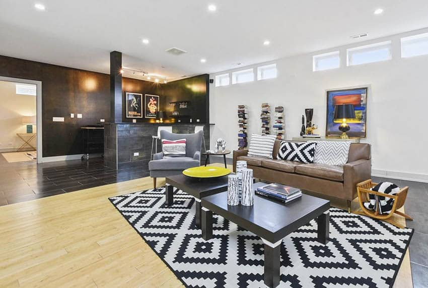 Large modern finished basement with living room and home bar
