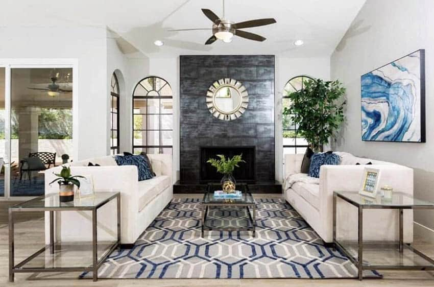 Living room coffee table layered decor black accent tile fireplace