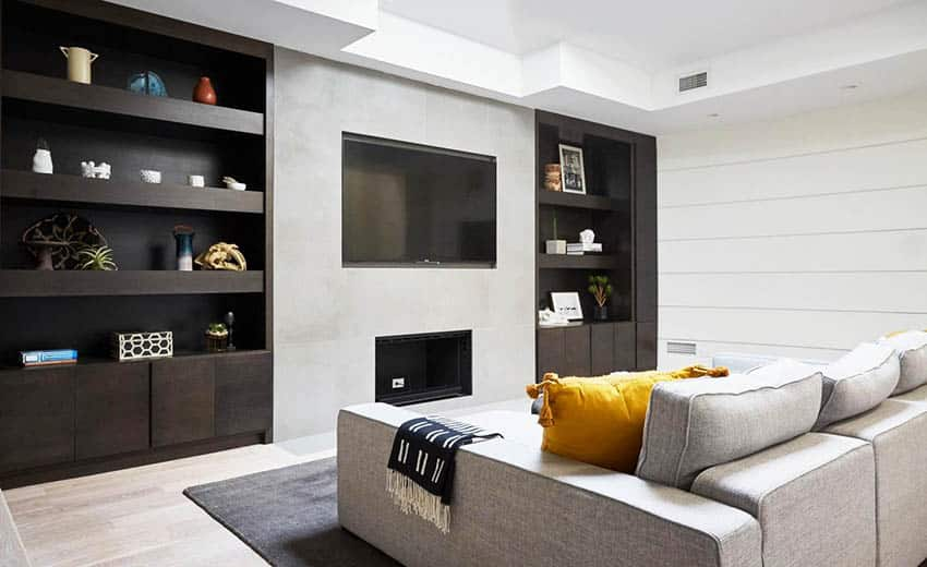 Modern basement living room with wall storage units