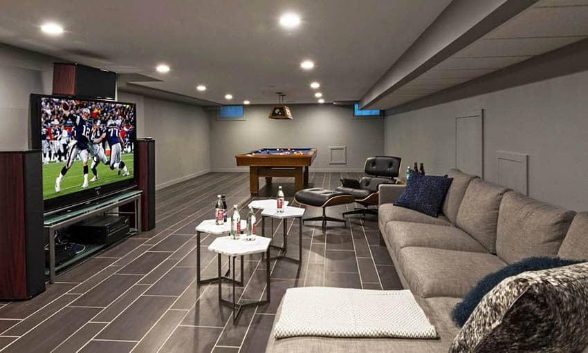 Modern basement man cave design with sectional couch