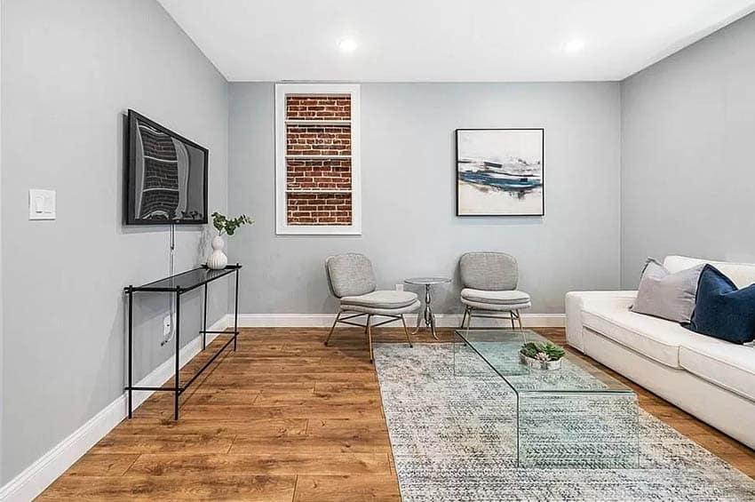 Modern basement with faux window