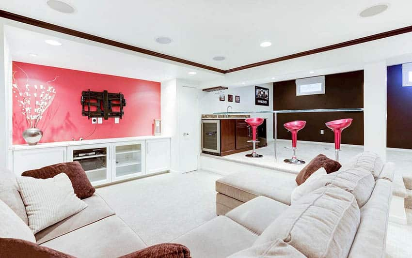 Modern basement with lounge home bar and pink accent wall