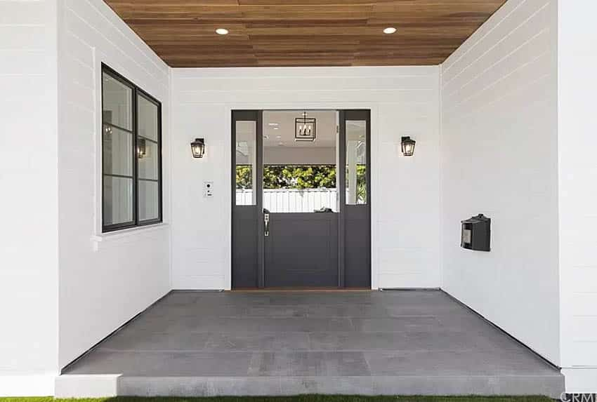 Modern dutch door in dark gray with sidelights