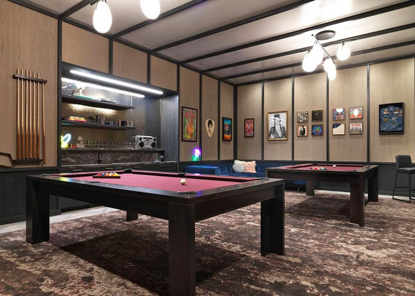 Modern game room with two pool tables