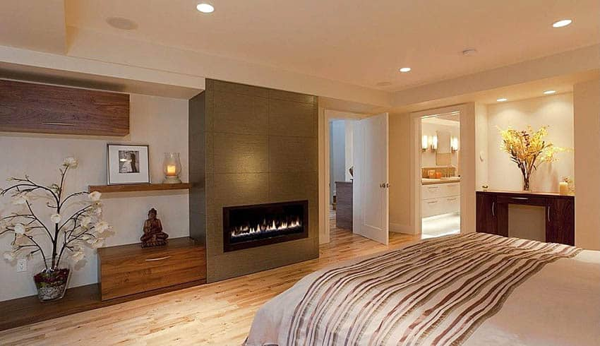 Modern master bedroom with gas fireplace and bathroom