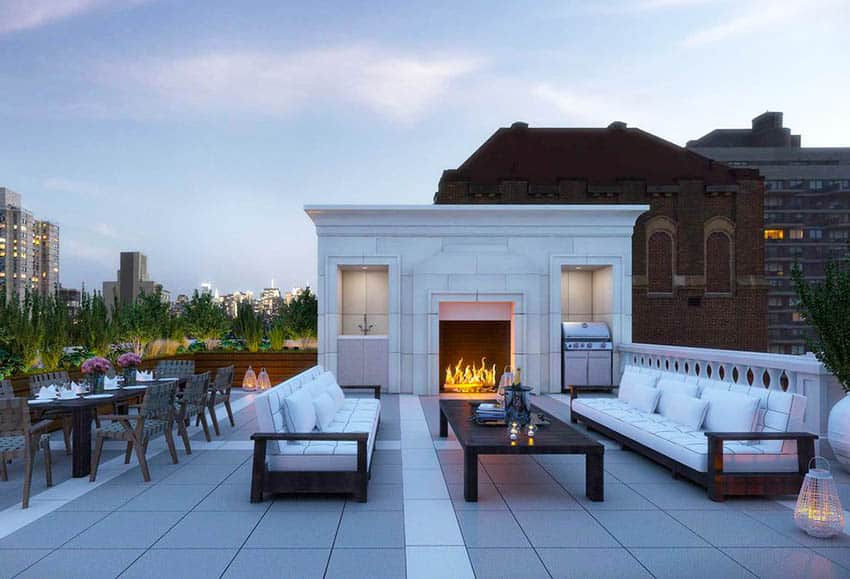 Modern rooftop deck with pavers outdoor fireplace and furniture