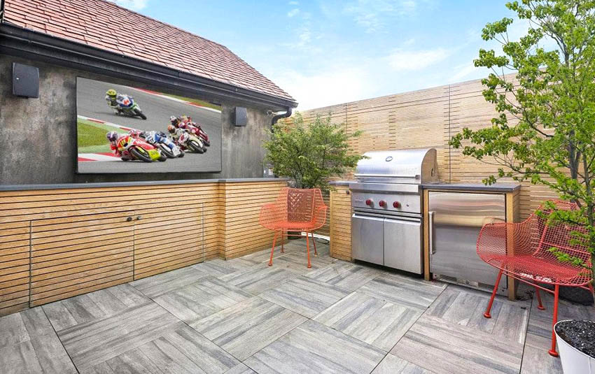 Rooftop deck with outdoor tv and privacy wall